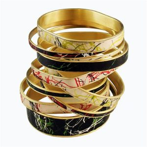 Silk Screened Bangles by Louise Fischer Cozzi Brass bracelet blanks sold at shadesofclay.com